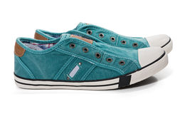Pair of green canvas sneakers Stock Photography
