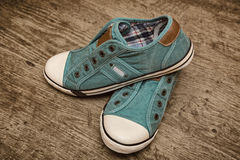 Pair of green canvas sneakers Royalty Free Stock Photo