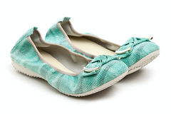 Pair of green female shoes. Over white background stock photo