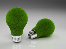 Pair of Green Grass Light Bulbs. A set of green light bulbs on a clear gradient background. This symbolizes environmental friendliness en ecologically sound stock illustration