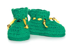 Pair of green knit baby bootees Royalty Free Stock Photography