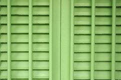 A pair of green painted wooden window panels Royalty Free Stock Image