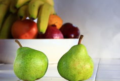 Pair of Green Pears in a kitchen Royalty Free Stock Images