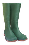 Pair of green rubber boots Stock Photos