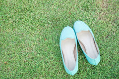 Pair of green shoes. On the green grass Royalty Free Stock Photo