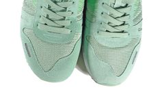 Pair of green shoes, trainers. Pair of green trainers, shoes on the white background, isolated Royalty Free Stock Image