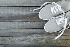 Pair of grey shoes. On wooden background Stock Photo