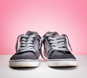 Pair of grey sneakers on colorful background Royalty Free Stock Photos