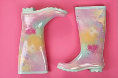 Pair of gumboots on color background. Top view. Female shoes Stock Photo