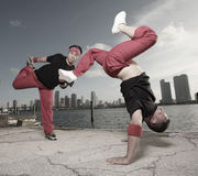 Pair of guys performing acrobatic stunts Royalty Free Stock Photos
