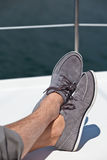 A pair of hairy man legs in topsiders Stock Images