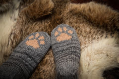 Pair of a hand knitted woolen socks with a cat paw pattern Stock Photography