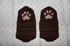 Pair of a hand knitted woolen socks with a cat paw pattern Royalty Free Stock Photos