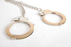 A pair of handcuffs. Handcuffs on white background. Sex toy stock photo