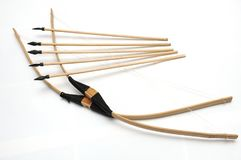 A pair of handmade wooden short bows with some arrows. A photo taken on a couple of handmade short bows and arrows against a white backdrop. The tips of the Royalty Free Stock Images
