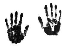 Pair of hands. A pair of black ink hand-prints Royalty Free Stock Images