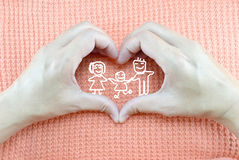 Pair of hands creating heart shape on knit fabric background Stock Photos