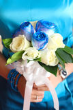 Holding a bouquet of flowers Royalty Free Stock Photos