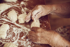 Pair of hands making pies from dough Stock Image