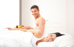 Pair having breakfast in bed Royalty Free Stock Photo