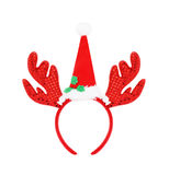 Pair of headband reindeer horns and santa hat isolated on white Royalty Free Stock Image