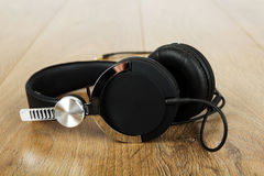 Pair of headphones on a rustic wooden surface Stock Image