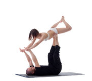Pair of healthy yoga trainers practising in studio Royalty Free Stock Image