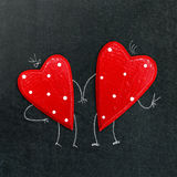 Pair of hearts on a chalk board. A pair of hearts on a chalk board Stock Photo
