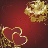 Pair of hearts with colours. Two hearts on a red background with gold colours Royalty Free Stock Photo