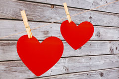A pair of hearts pegged on a line Royalty Free Stock Photo