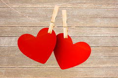 A pair of hearts pegged on a line Stock Images