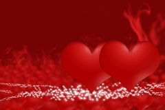 Pair of hearts on a red smoke background Stock Image