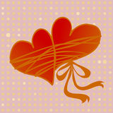 Pair of hearts tied together by love. On a festive background Royalty Free Stock Photos