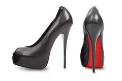 Pair of high heel shoes. Black high hill shoes isolated on white royalty free stock images