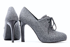 Pair of high-heeled female shoes Stock Photos