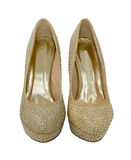 Pair of high heeled gold shoes, decorated with crystals Royalty Free Stock Image