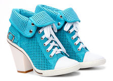 Pair of high-heeled turquoise female shoes. On the white background Royalty Free Stock Photos