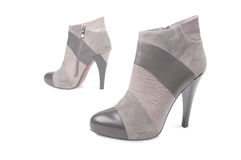 Pair of high-heels shoes. Pair of grey high-heels shoes, isolated on white Stock Image
