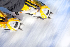 Pair of high mountain boots with crampons in the snow. Royalty Free Stock Photo