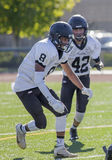 Pair of High School football players Royalty Free Stock Photo