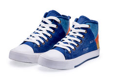 Pair of high top color denim gymshoes Royalty Free Stock Image