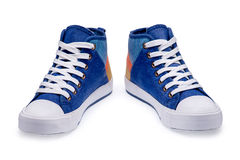 Pair of high top color denim gymshoes Stock Photo