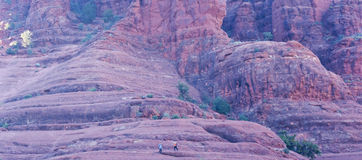 A Pair of Hikers Descend Bell Rock. Near Oak Creek Village, South of Sedona, Arizona Royalty Free Stock Images