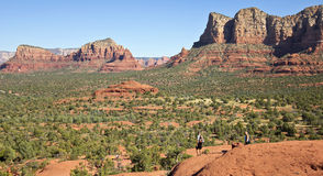 A Pair of Hikers Descend Bell Rock. SEDONA, ARIZONA, OCTOBER 13. Bell Rock Trail on October 13, 2015, near Sedona, Arizona. A Pair of Hikers Descend Bell Rock Royalty Free Stock Photo