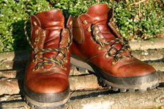 A pair of hiking boots. A pair of well worn leather hiking boots Stock Images