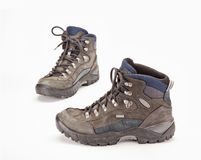 A pair of hiking boots. On white background Royalty Free Stock Images