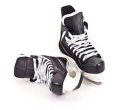 Pair of hockey skates Stock Photos