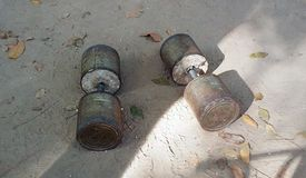 A pair of homemade dumbells. On the ground at a local public park Royalty Free Stock Photography