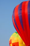 Pair of hot-air balloons. Two hot-air balloons rising into the blue sky Stock Photography