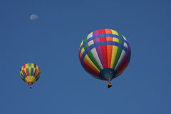 Pair of hot air balloons. A pair of hot air balloons in a blue sky Royalty Free Stock Image